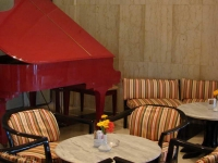 Magawish Village Resort (ex.Magawish Swiss Inn Resort) - lobby cafe  рояль